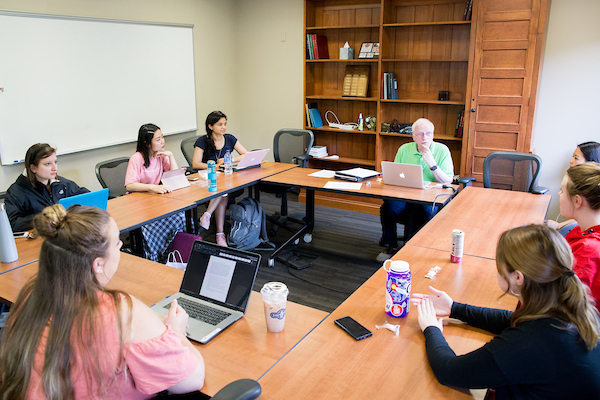 group of students and professor sit in a uw madison classroom